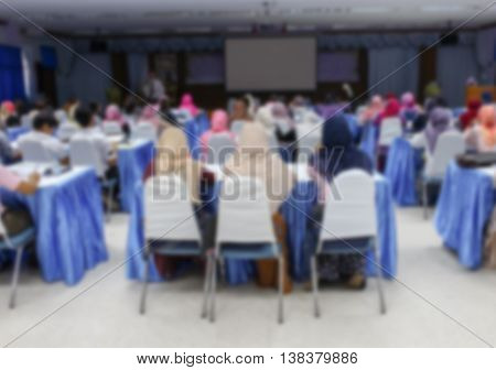 university students sitting in a lecture classroom with Movie screen. Blur blurred  abstract