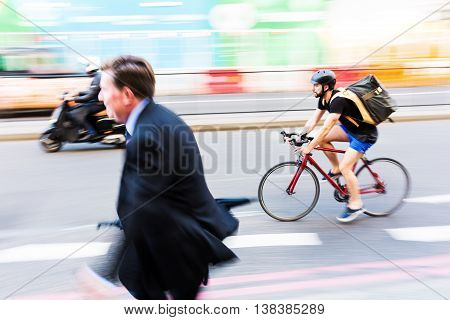 Cyclist And Businessman In Motion Blur In The City Traffic Of London, Uk