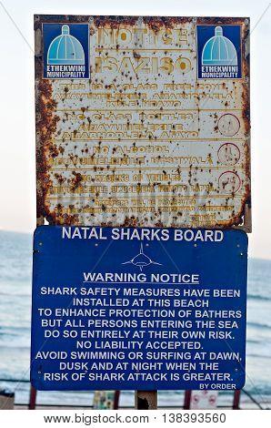 DURBAN SOUTH AFRICA - JULY 13 2016: Ethekwini Municipality notice and Natal Sharks Board Warning Notice on the promenade at Umhlanga Rocks