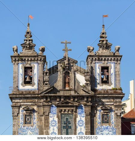 PORTO, PORTUGAL - JUL 12, 2016: Facade of Church of Saint Ildefonso. Completed in 1739, church was built in a proto-Baroque style and features a retable by Italian artist Nicolau Nasoni.