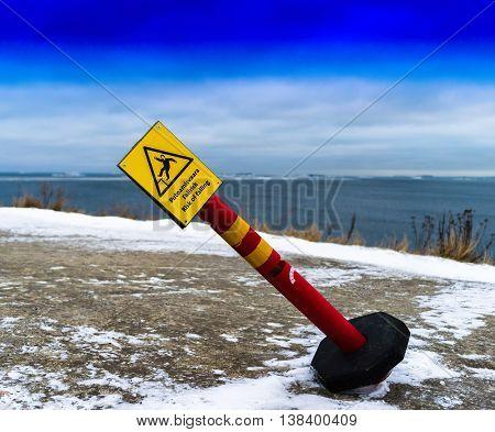 Horizontal vivid tilted risk of falling sign background backdrop