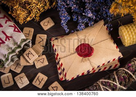 Bunch Of Dried Herb That Usually Is Used In Different Ritual, Magic And Cleaning, runes, old envelope with wax stamp and candle