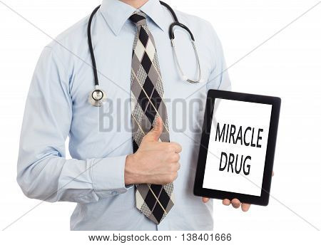 Doctor Holding Tablet - Miracle Drug