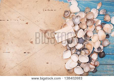 Shells And Sand With Sign - Time Is Coming. Vocation And Travel Background