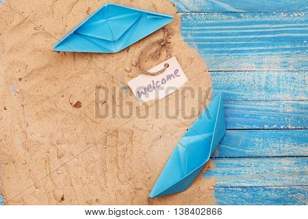 Paper Boat With Shells And Sand With Sign - Welcome. Vocation And Travel Background