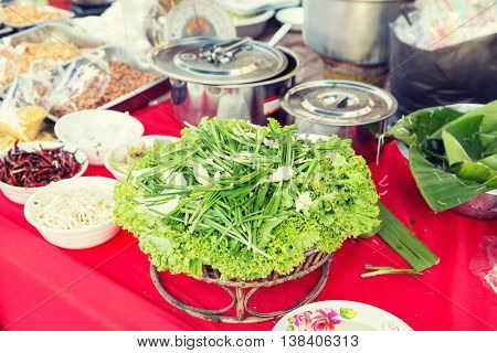 cooking, asian kitchen, sale and food concept - foodstuff and spices sale at street market