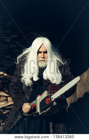 Old Man With Chainsaw