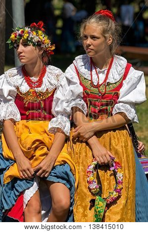 ROMANIA TIMISOARA - JULY 10 2016: Young girls from Poland in traditional costume present at the international folk festival