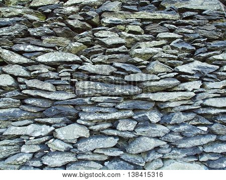 Texture of old stony wall from nature marlite material, broken marl stone , traditional building materials.