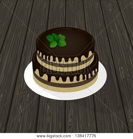 two-tier sponge chocolate cake with mint sprig on a plate. wood texture in the background.