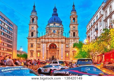 Budapest, Hungary-may 05,2016: St. Stephen Basilica In Budapest At Nightime And Sport Car Show With