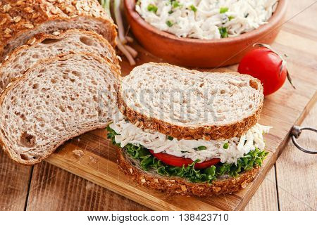 chicken salad sandwich tomato salad оn  desk