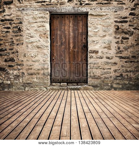 Abstract empty room interior background with brow wooden floor and closed door in brick wall