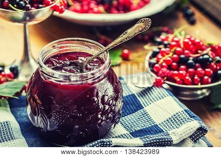 Red and black currants. red currant jam with fresh berry.