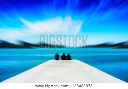 Horizontal Vivid Three Freinds Sitting On The Quay Motion Blur A