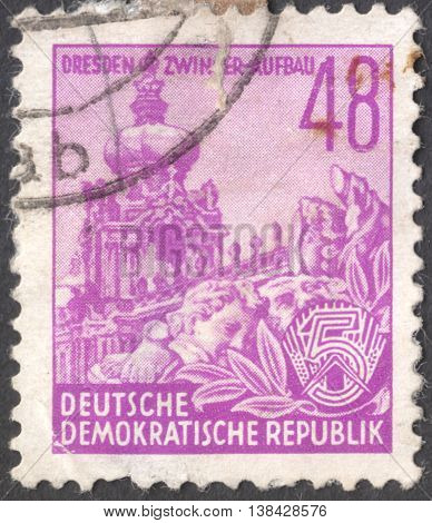 """MOSCOW RUSSIA - JANUARY 2016: a post stamp printed in DDR shows Zwinger with inscription """"Dresden Zwinger construction"""" the series"""