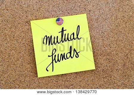 Written Text Mutual Funds Over Yellow Paper Note
