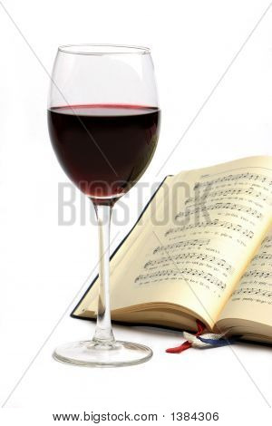 A glass of red wine with note book. poster