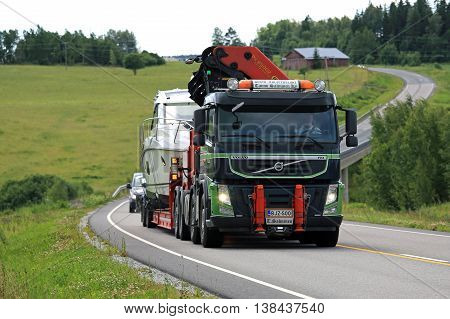 SALO, FINLAND - JULY 8, 2016: Volvo FM semi boat transport of Tauno Salminen Ky on the road in South of Finland at summer.