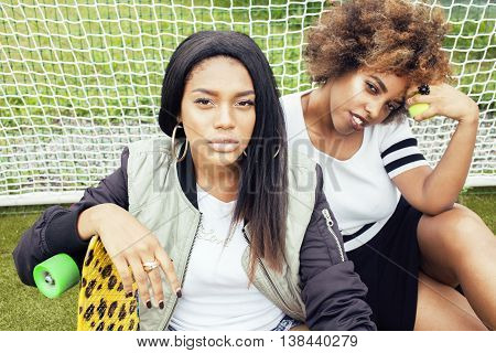 young pretty multi ethnicity afro-american girls having fun on foothball field, fan club of swag teenagers, lifestyle people concept
