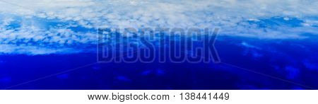 Above the blue sky dramatic cloudscape background backdrop