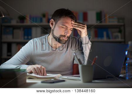 Sleepy Young Man With Headache