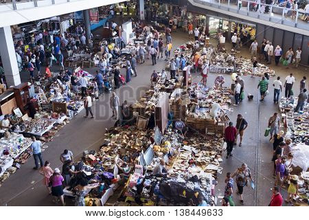 BARCELONA, SPAIN - JULY 9: People at Els Encants flea market on July 9, 2016 in Barcelona, Spain. This popular flea market in the city is full of an assortment of used bits and pieces on sale