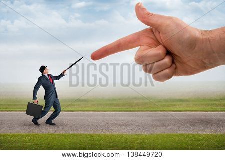 giant finger pointing aggressively at a defensive businessman