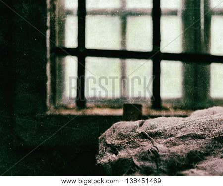 Square scratched prison window bunk composition background