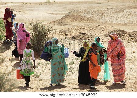 SUDAN - JANUARY 09: Sudanese people walking from a bazaar in rural area near Khartoum on January 29, 2010 in Sudan