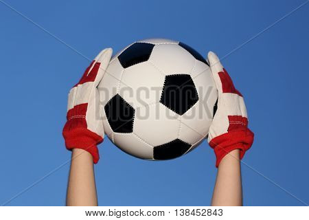 goal keeper with ball and blue sky background
