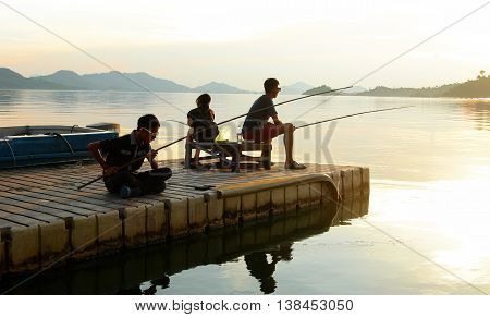 Fishing by the jetty of Batang Ai Longhouse Resort, Sarawak, Malaysia.