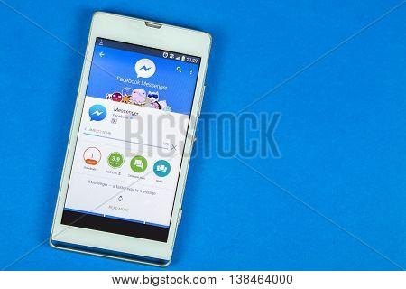 BUNG KAN THAILAND - FEBRUARY 19 2016: smart phone display facebook messenger app on blue background