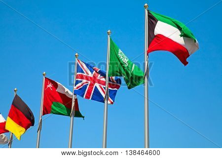 Middle east and european coutries flags in the blue sky