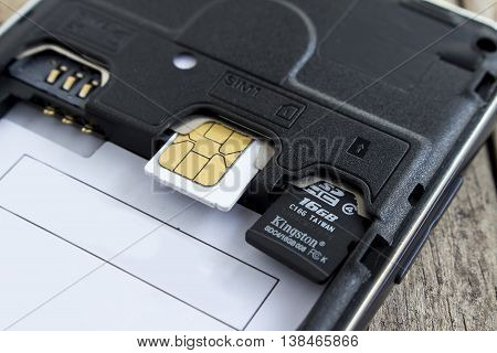 BUNG KAN THAILAND - APRIL 04 2016: sim card and micro sd card in slot of smart phone soft focused