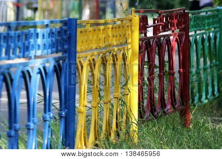 multicolored metal fence made of red, yellow, green, and blue colors