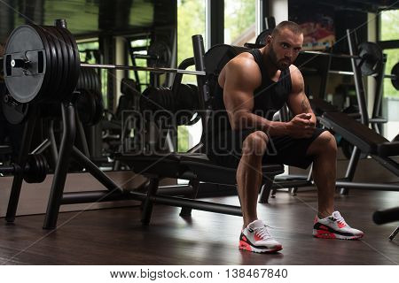 Muscular Man Resting On The Bench