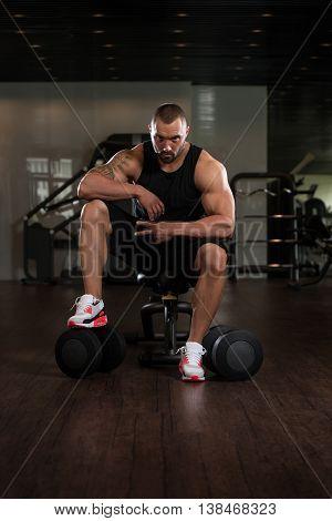Bodybuilder Resting At The Bench