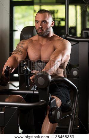 Bodybuilder Exercise Back On Machine