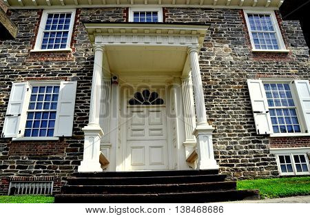 Yonkers New York - August 6 2012: Fieldstone south front and portico doorway of Georgian Philipse Manor built in 1693