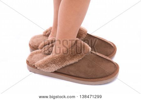 Close up of beautiful brown leather slippers on white background isolated