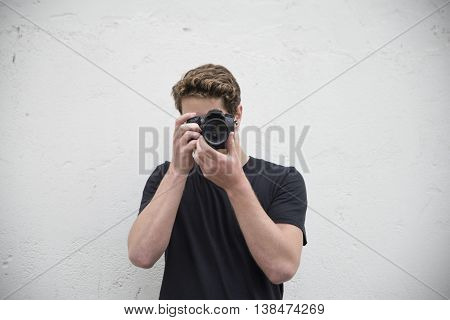 portrait of a cool dude taking photos