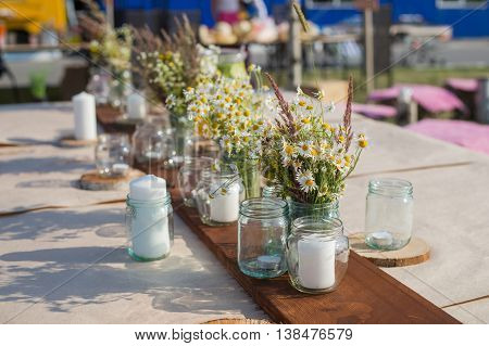 Beautiful table set with candles and flowers for a festive event, party or wedding reception.