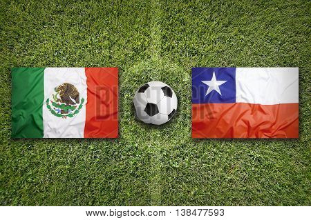 Mexico Vs. Chile Flags On Soccer Field