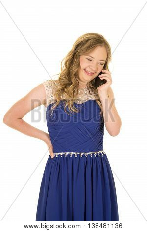 a woman with down syndrome with a smile on her face talking on her phone.