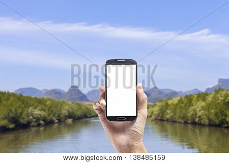 Hand male asian holding Smartphone of mangrove forest backgroundtravel concept