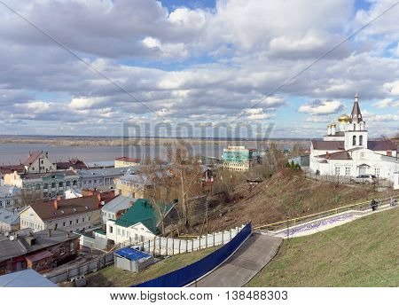 View from the high bank of the Oka River in the street Christmas and Church of Elijah the Prophet