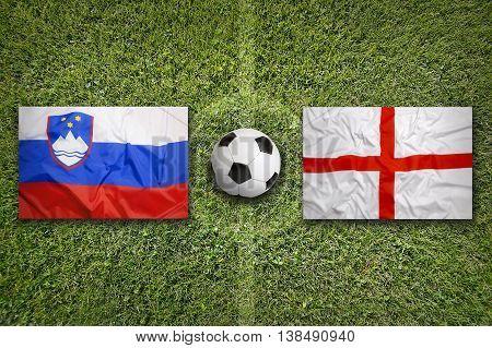 Slovenia Vs. England Flags On Soccer Field