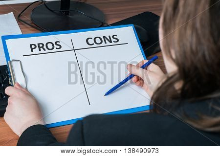 Business Woman Writes Pros And Cons In Two Columns To Decide Dil