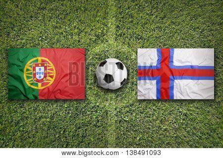Portugal Vs. Faeroe Islands Flags On Soccer Field